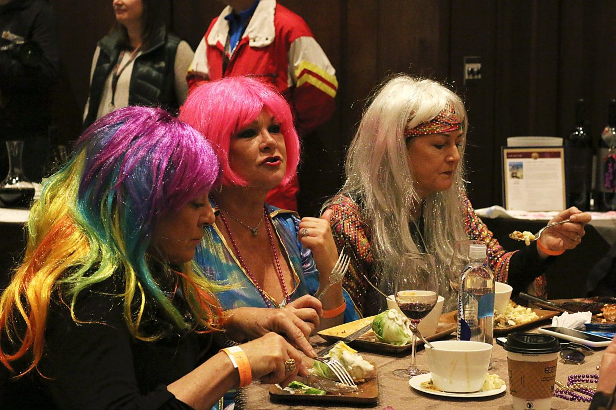 Antoinette Latini, Vicki Capizzi and Stefanie Hultz enjoy food and drink at the Wine on the Mountain event on March 2, 2018. The event is part of a series of events during the Red, White and Snow fundraiser benefitting the National Ability Center. (Kira Hoffelmeyer/Park Record)