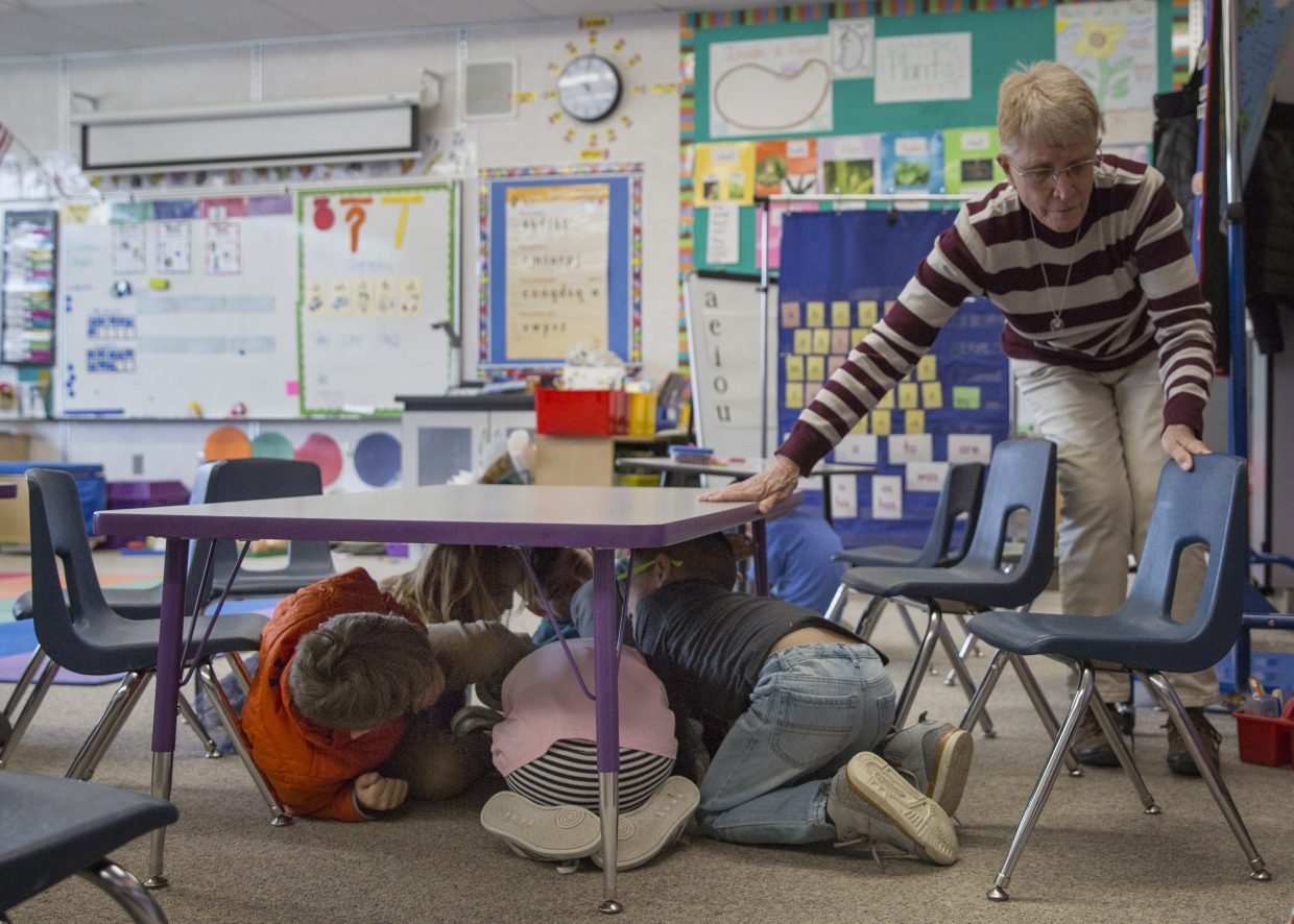 McPolin Elementary School kindergarteners huddle under a table as they participate in the Great Utah Shakeout earthquake drill on April 19. All schools in the Park City School District participated in the statewide event, where they practiced what steps to take in an earthquake.