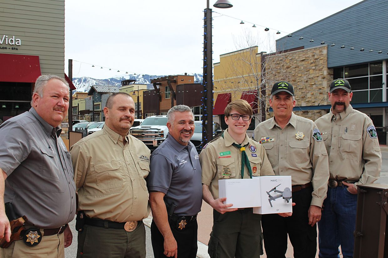 Park City Boy Scout Will Sunderland, third from right, presented a drone to Summit County Search and Rescue liaison Lieutenant Alan Siddoway, left, Commander Lance Livingston, and Sheriff Justin Martinez on Wednesday in Kimball Junction. Sunderland was accompanied by Kurt Vernon, commander of Park City Troop 1504, and Ryan Miller, Coalville leader, left. Sunderland raised more than $1,400 to purchase the drone for search and rescue as part of his Eagle Scout project.