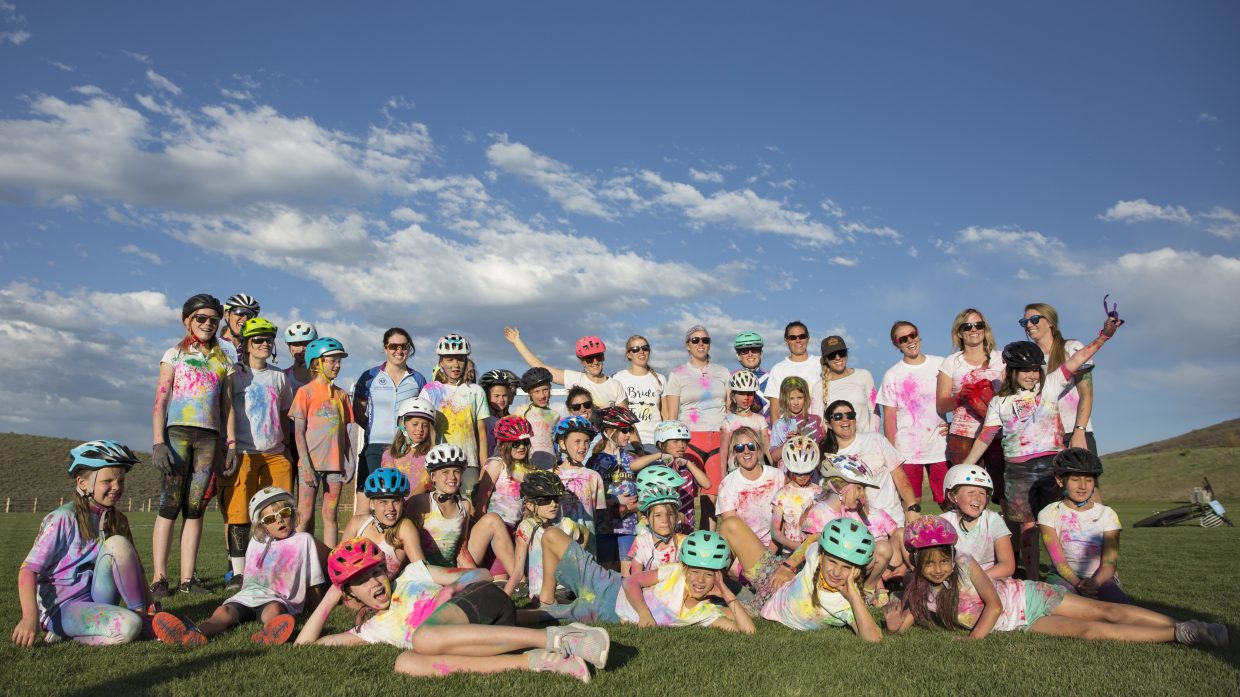 The Little Bellas Biking group and their mentors pose for a group photo on the soccer field in Trailside Park Wednesday afternoon, May 16, 2018. The group was dusted in a variety of colors during their color day festivities. (Tanzi Propst/Park Record)