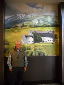 Local artist unveils McPolin Barn mural at Club Wyndham