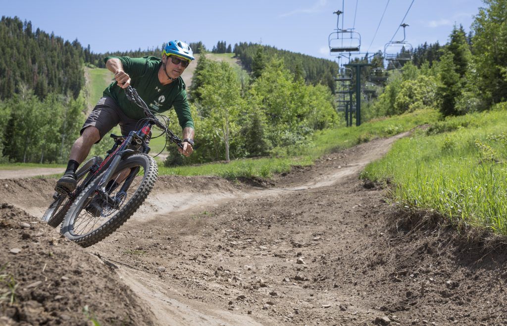 95d512fa93d Doug Gormley, lead bike coach at Deer Valley Resort, rides one of the  resort's trails on an e-bike. Gormley said the resort has worked with Park  City and ...