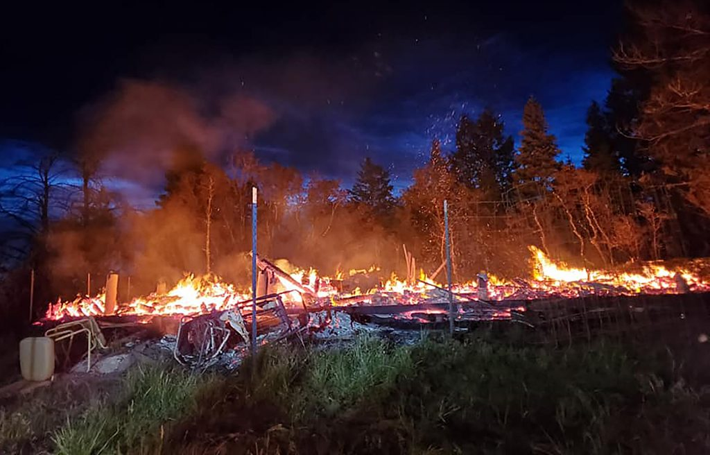 Firefighters, aided by wet conditions, prevent Summit County cabin fire from spreading