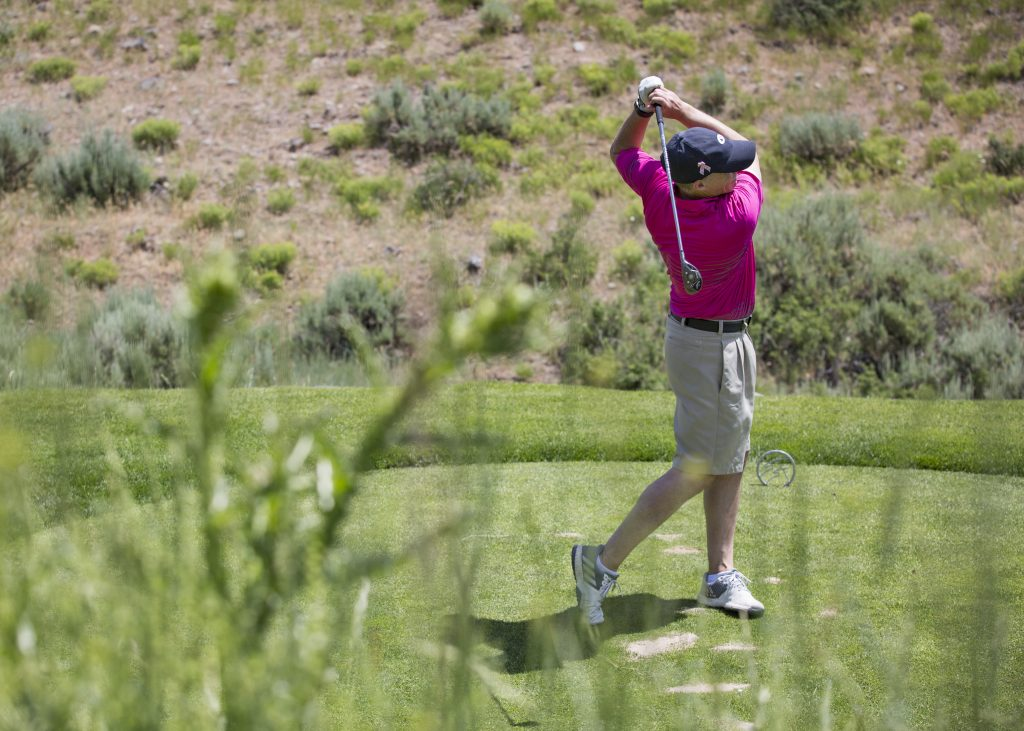 Parkites play 100 holes of golf in one day to support fight against breast cancer